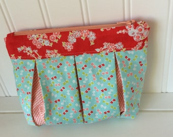 Aqua and red pleated zippered pouch