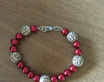 Tan flower beads with red accents