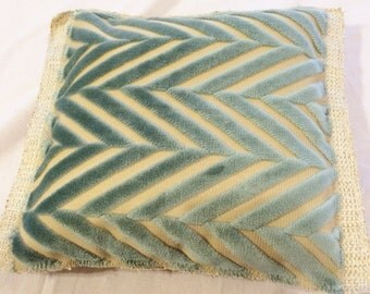 Throw pillow with criss cross pattern