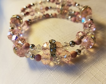 Pink glass, crystal and rondelle beaded bracelet.