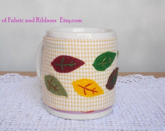 Cup cosy. Felt Autumn leaves cup cosy. Handmade cup cosy. Cotton cup cosy.