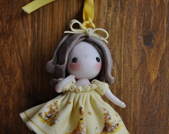 Sweet doll hanging in cold porcelain