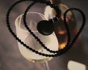 Black beads, rosary style with Wishing stone