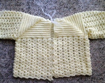 Hand Crocheted Baby Sweater in lemon yellow