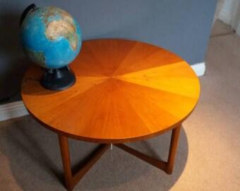 Fabulous circular coffee table by McIntosh. Stunning teak veneer.