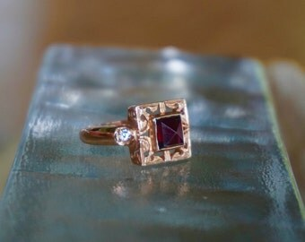 Garnet Ring set in rose gold with CZ