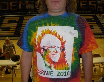 Bernie Rainbow Tye Dye  medium with a Bernie or Bust fist print on the back in metallic gold