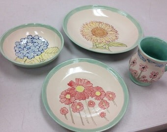 4 piece place setting  of stoneware