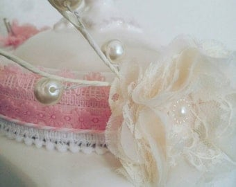 Pink and lacy vintage inspired baby headband with a touch of pearls