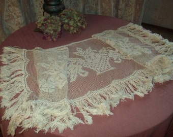 A stunning top from old furniture, which can be used as curtain or valance
