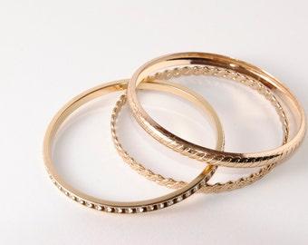 Vintage gold-tone bangles, set of 3, rhinestone, etched, braided.