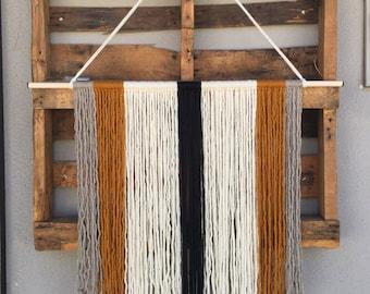 large yarn wall hanging