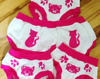 Pink cotton training pants your kids will love!! Paws show where to hold with animal face on the front and tail on the back.