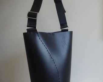 Hand-stitched black leather bucket
