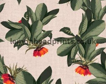 Tropical leaves design with greens, oranges and reds on a textured background available on a variety of fabrics