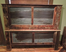 Reclaimed Wood Bed Frame With Corrigated Steel Headboard.