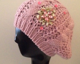 Pale pink beanie bedazzled/decorated with pink accents