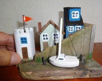 Watchtower, a driftwood harbour scene art seaside. Boats, fishing cottages.
