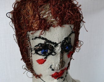 Blue eyed hand stitched doll