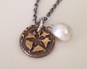 Bronze Sand Dollar Pendant And Pearl On Antiqued Sterling Silver