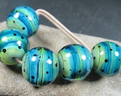 Aqua and lime encased striped round lampwork beads