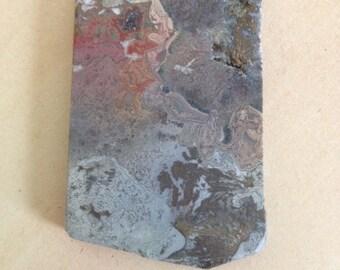 rough rock slab, red, gray, green
