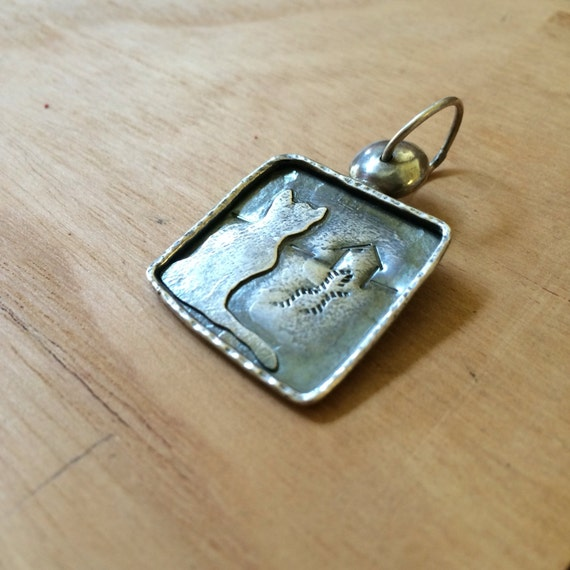 Cat longing for home sterling silver pendant