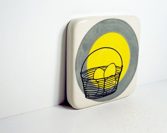 tile of an egg basket on a color block of storm grey & yellow. Made to Order.