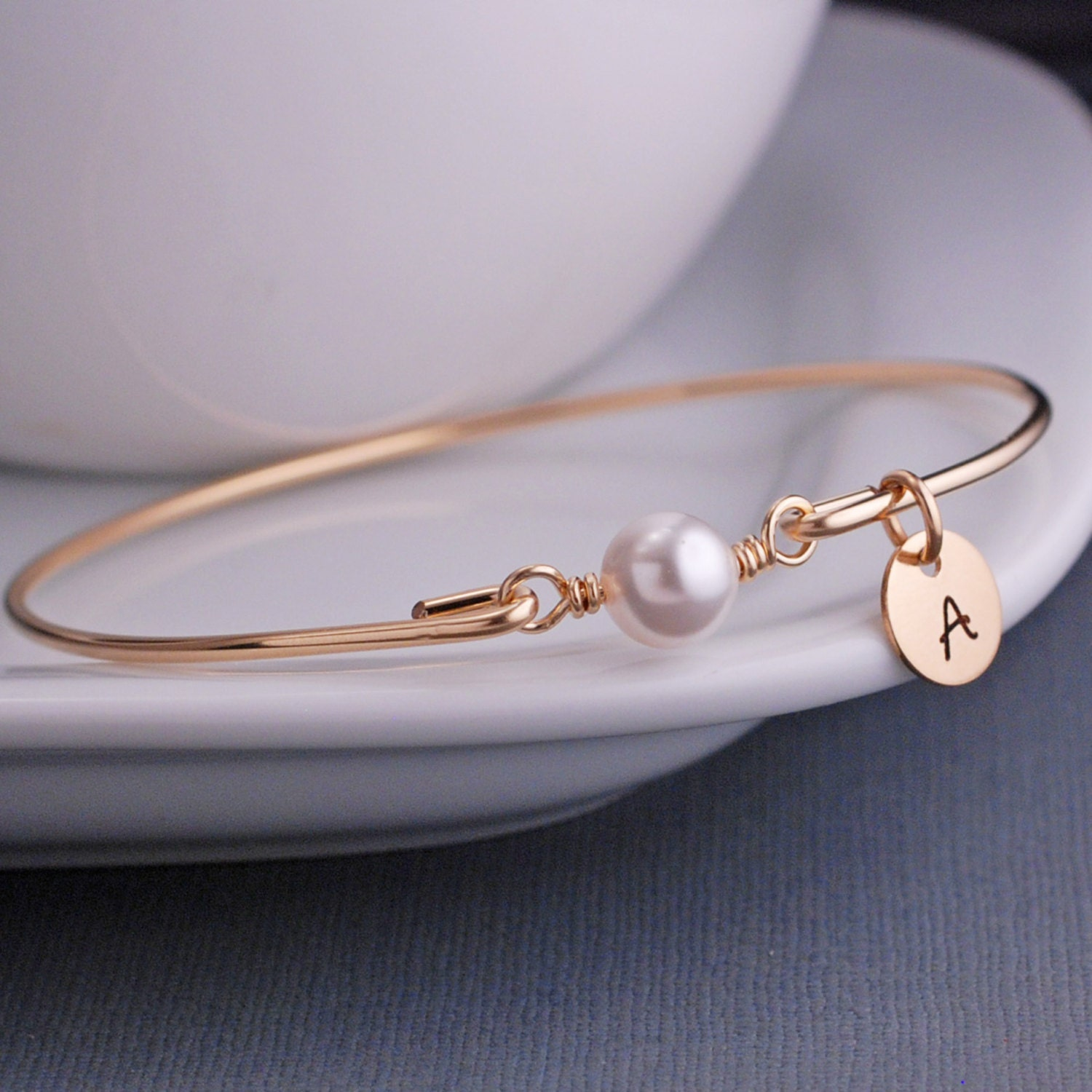 Engraved pearl bracelet with name charm
