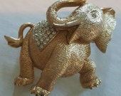 Vintage golden laughing elephant brooch