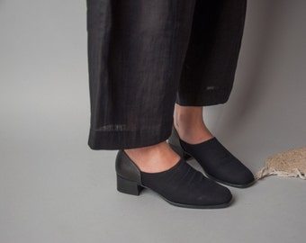 ezra black stretch leather booties / simple flats / 5.5 M / 557s