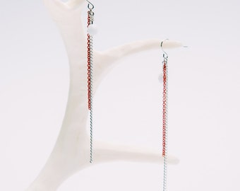 Minimal earrings with silver and orange neon multiple chains and faceted white bead