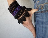 beaded crochet bracelet with purple and burgundy embroidered base and black beaded lace