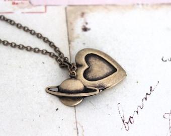 planet. heart locket necklace. in brass ox jewelry