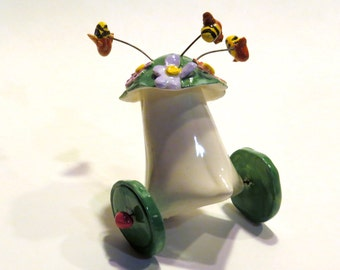 Ceramic Wheely Toy with Bees in a Flower Garden on Top