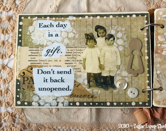 Mixed Media Chipboard Journal with collage images and sari ribbons