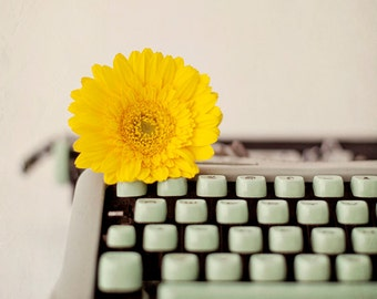 Still life photography, mint green, yellow vintage typewriter, flower, gerbera, daisy, typewriter photography - A Sunshine Story