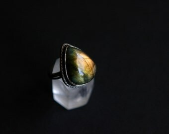 Natural yellow fire labradorite oxidized sterling silver ring with drop shaped textured setting. Size 8
