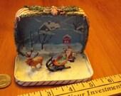 Santa in an altoids tin