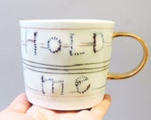 Hold me - porcelain cup with translucent bottom