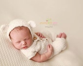 Cream colored, one piece and teddy bear bonnet