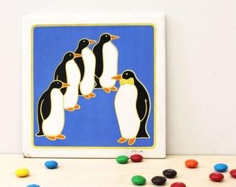 Penguins. Vintage 1980s tile with cork backing.