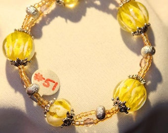 Yellow and purple Necklace and matching bracelet and earrings