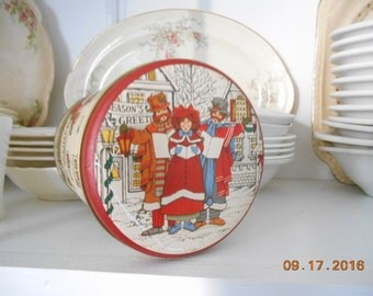 Vintage Christmas Round Metal Tin Can with Carolers singing in old fashion town