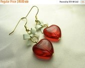 Heart earrings ... red glass hearts with white bows ... young love