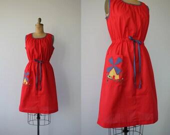 vintage 1960s dress / 60s red dress / 60s house dress / 60s windmill dress / drawstring waist / sleeveless dress / medium large xl