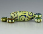 handmade lampwork glass bead with spacers an oval silverglass focal with opal yellow stringer patterns - Night Music