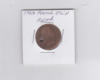 1864 french coin with a hole in it
