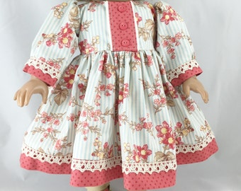 18 Inch Dolls Long Sleeved Dress Pretty Blue Stripes Overlaid With Coral Flowers And Coral Accents with Matching Hair Bow