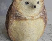 stoneware hedgehog, hedghog, squirrel, woodchuck